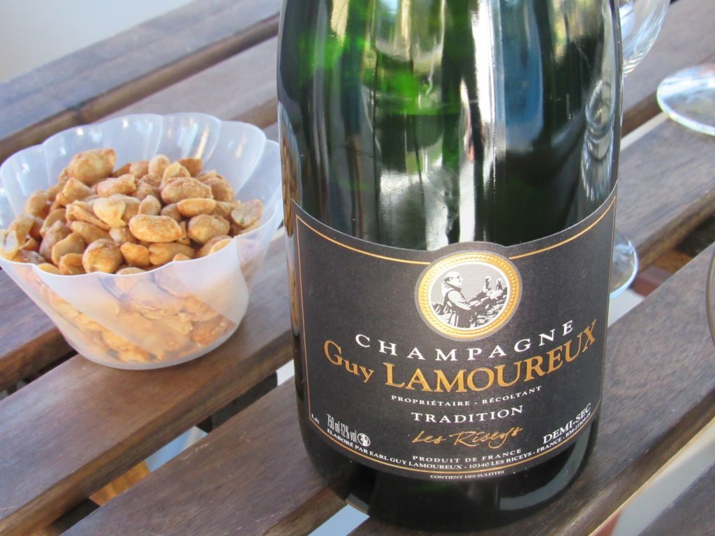 Champagne and peanuts on the back deck
