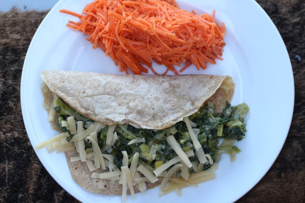 Wholewheat crepes with sauteed leeks, kale and vegan cheese plus Frenach carrot salad