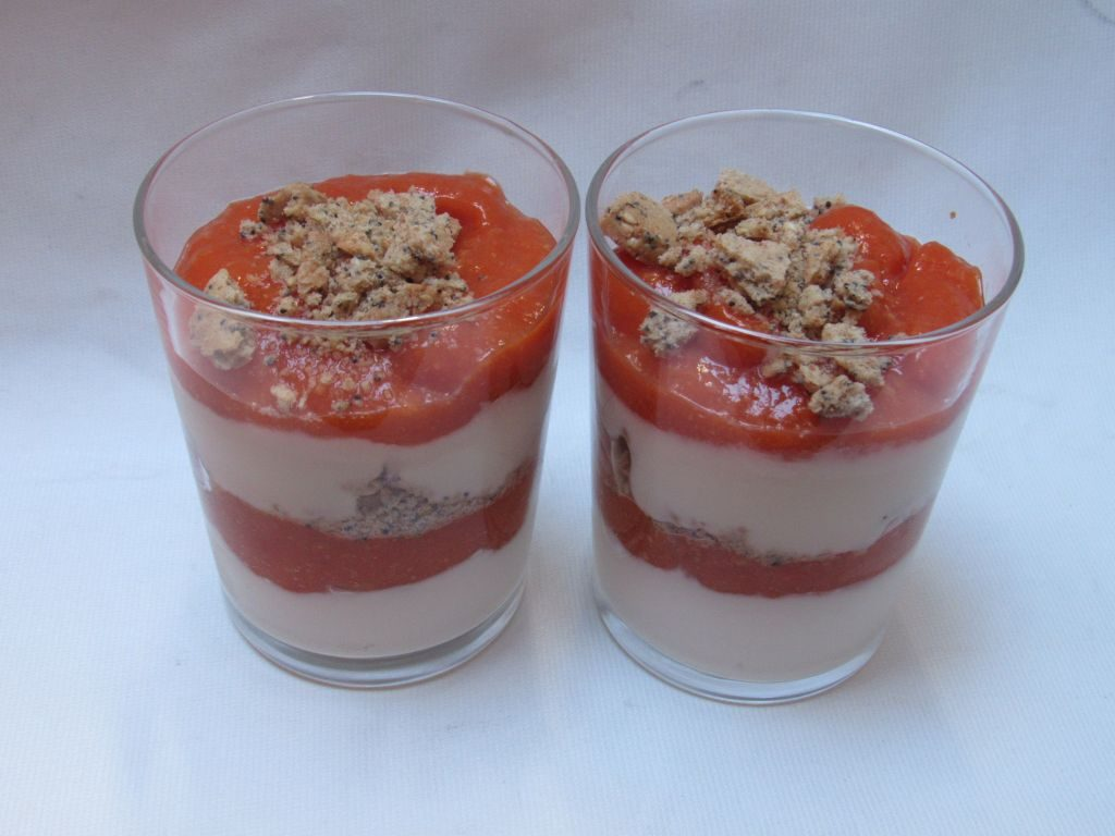 Stewed apricots, soy yogurt and crushed biscuit parfait