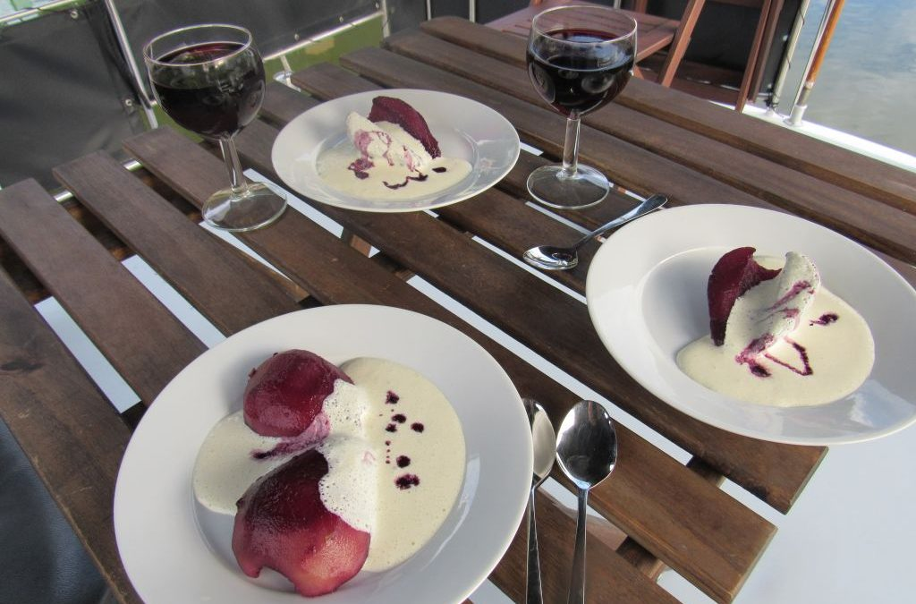 Poached pears in red wine with soy creme anglaise