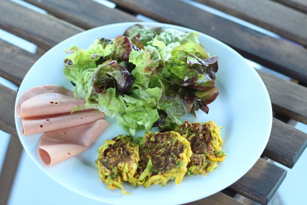 Flat curried courgette falafels with vegan ham and green salad